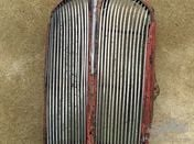 Grille with mascot and crankhandlecover for Standard Nine .1940s