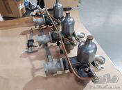 triple carburettor system for an Alvis